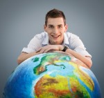 Man Smiling with a Globe